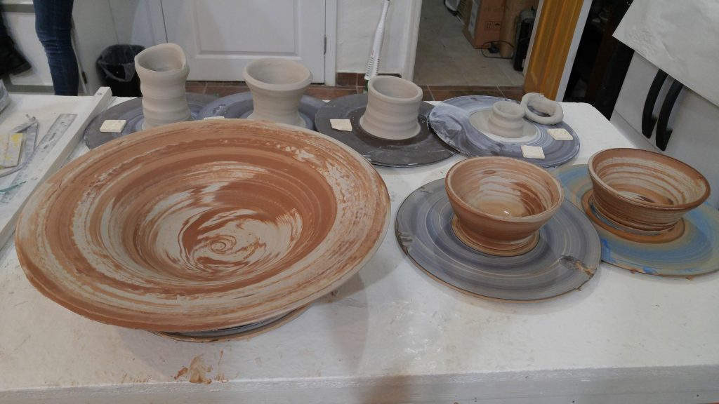 terracotta and white clay mixed bowls created in intermediate wheel throwing class